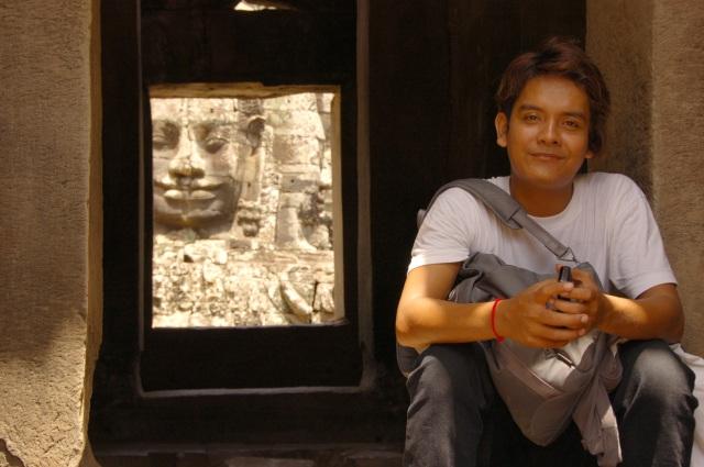 reflections of faces at Angkor Wat